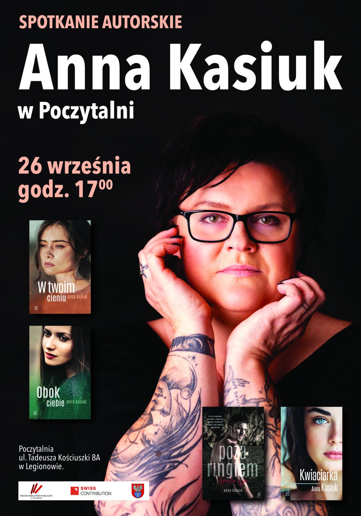 """Na plakacie na pierwszym planie zdjęcie autorki, napis """"Anna Kasiuk w Poczytalnia. 26 września godz. 17.00"""". Mniej wyróżnione okładki książek: """"W Twoim cieniu"""", """"Obok ciebie"""", """"Poza ringiem"""", """"Kwiaciarka""""."""